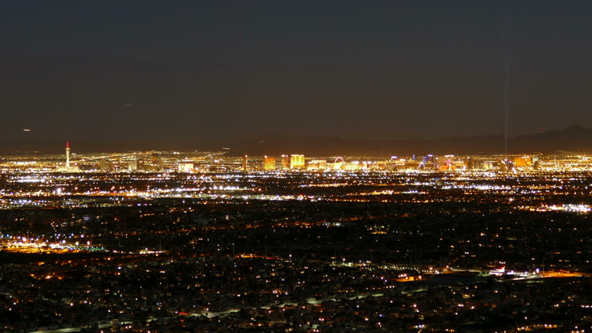 Las Vegas dusk to night cityscape mountaintop time lapse with zoom in. | Shutterstock HD Video #11561180