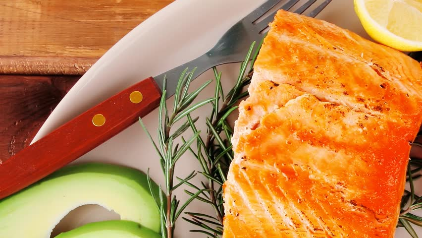 food: grilled salmon on big glass plate on wooden table 1920x1080 intro motion slow hidef hd
