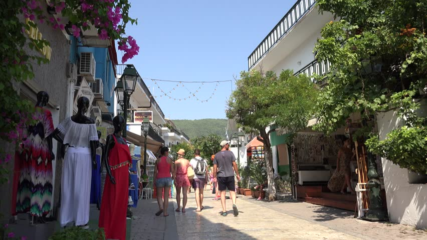 SKIATHOS ISLAND - GREECE, 5 AUGUST, 2015, 4K Traditional shop in old town with commercial road by day - 4K stock footage clip