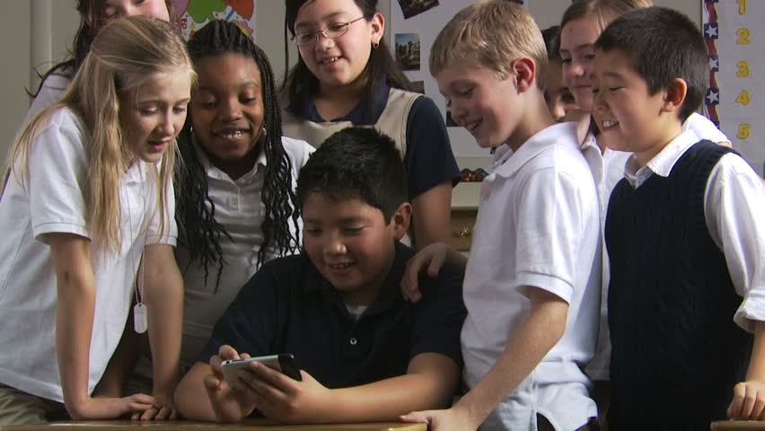 students looking on an iPhone
