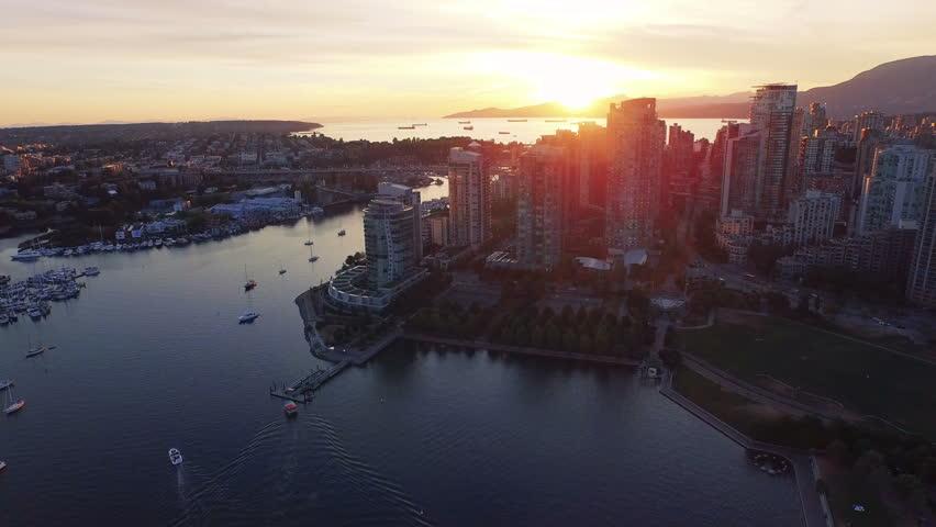 4K aerial shot of Vancouver Skyline at sunset.