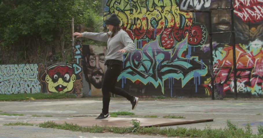 Toronto, Canada - August 2015 - A female professional break dancer performing an urban art routine - HD stock footage clip