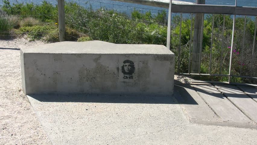 AUSTRALIA - OCTOBER 20 2014: An image of the Cuban revolutionary Che Guevara appears on a concrete bench in southern Australia. - 4K stock video clip