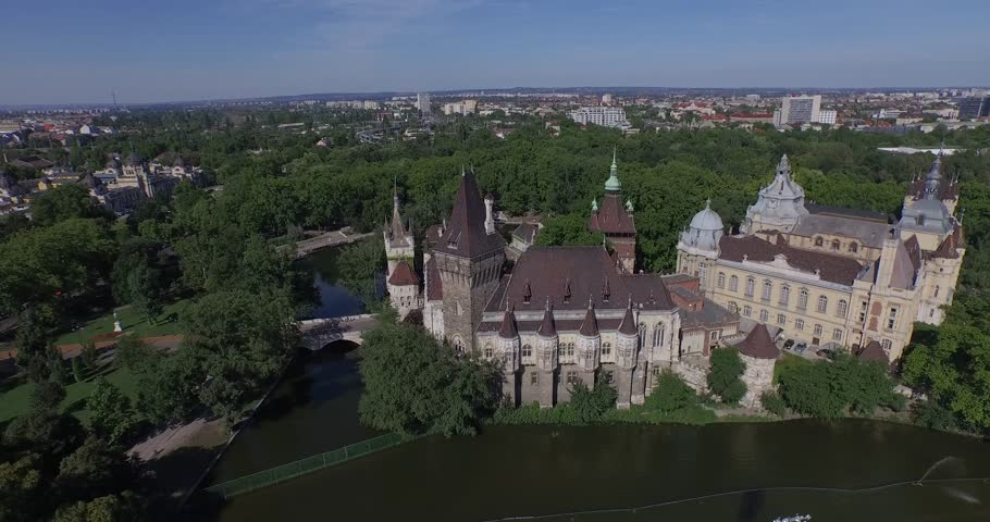 Aerial shots of Vajdahunyad Castle in Budapest, Hungary. Vajdahunyad Castle is one of the romantic castles in Budapest, located in the City Park by the boating lake / skating rink. - 4K stock footage clip