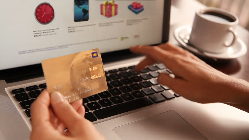 Online shopping. 3 shots. Dolly. Female hand holding a gold credit card and shopping online. More options in my portfolio. | Shutterstock HD Video #11744465
