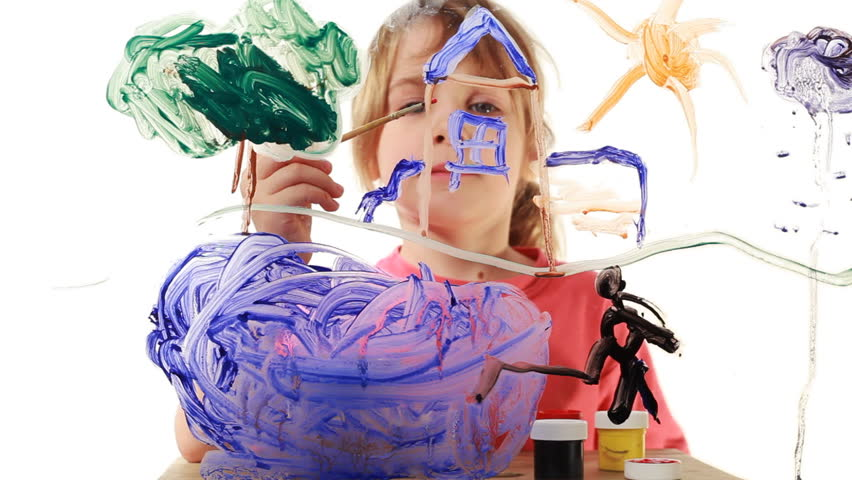 nice little girl begins to paint house wall in picture on transparent glass, behind white background - HD stock video clip