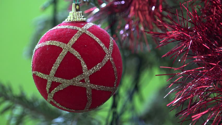 4K Closeup of red decorative ball hang in pine tree, Christmas ornament in indoor house  by day #11760494