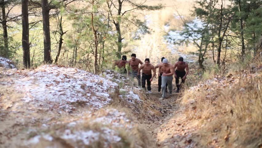 Six Young Half-naked Men Up Hill At Autumn On Old Railroad