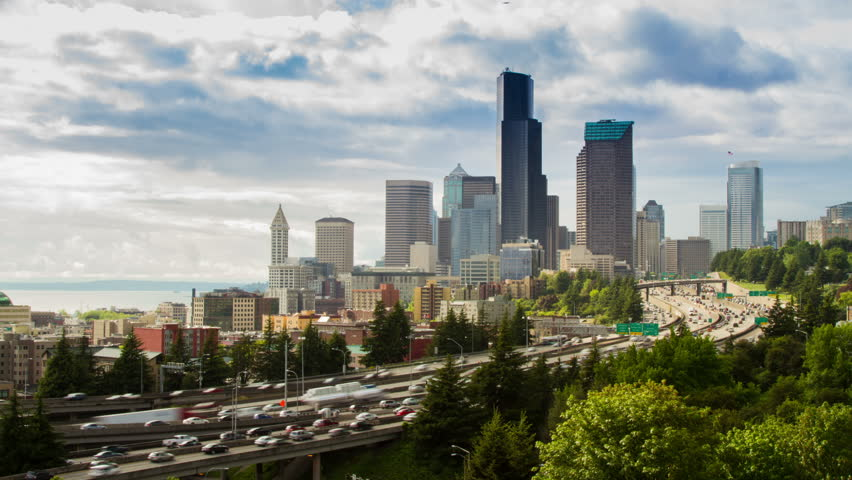 Freeway Traffic Time Lapse in Seattle. A cloudy afternoon, high impact busy traffic on highway 5 going on both direction