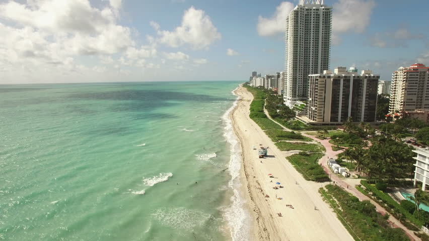 Aerial video of the waterfront, Miami Beach, 60th Collins Avenue. 4K Ultra HD. Shooting the video along the coastlines . | Shutterstock HD Video #11774615