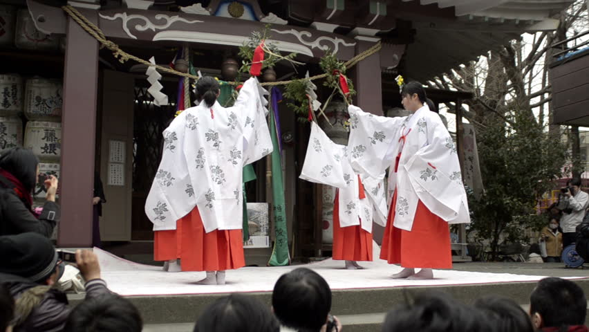 TOKYO - APRIL 03: Traditional religious dance at a shrine on April 03, 2011 in Kawasaki, Tokyo.  Most Japanese are Buddhist, Shintoist or both; About 91 million people in Japan claim to be Buddhist - HD stock video clip