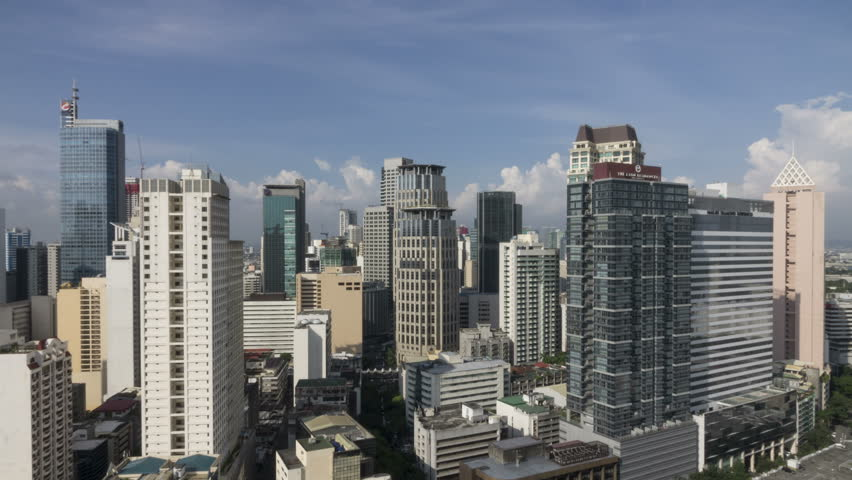 Manila, Philippines - Sept 23, 2015:Timelapse over Makati`s skyline. Makati is one of the most developed business district in Metro Manila, Philippines.