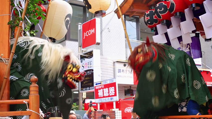CHOFU- Lion dance(shishimai), part of Choufu annual Festival, Japan. SEPTEMBER 23: Annual autumn festival. Hyottoko show accompanied by Taiko drumming in Chofu, Tokyo on September 23, 2015.