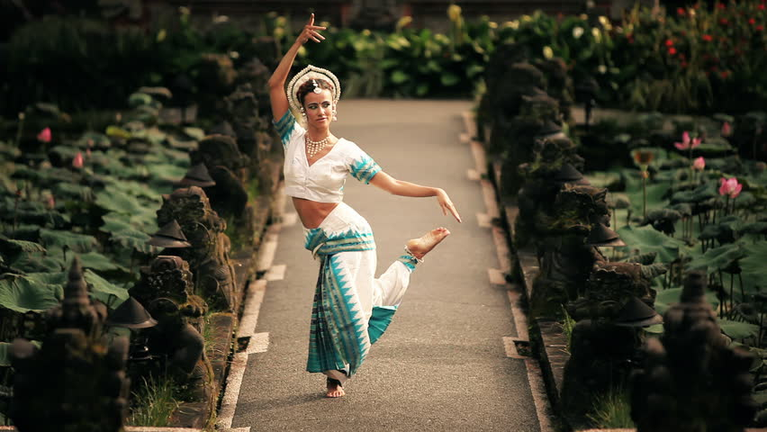 Series with dancing girl in front of a exotic backgrounds.  - HD stock video clip