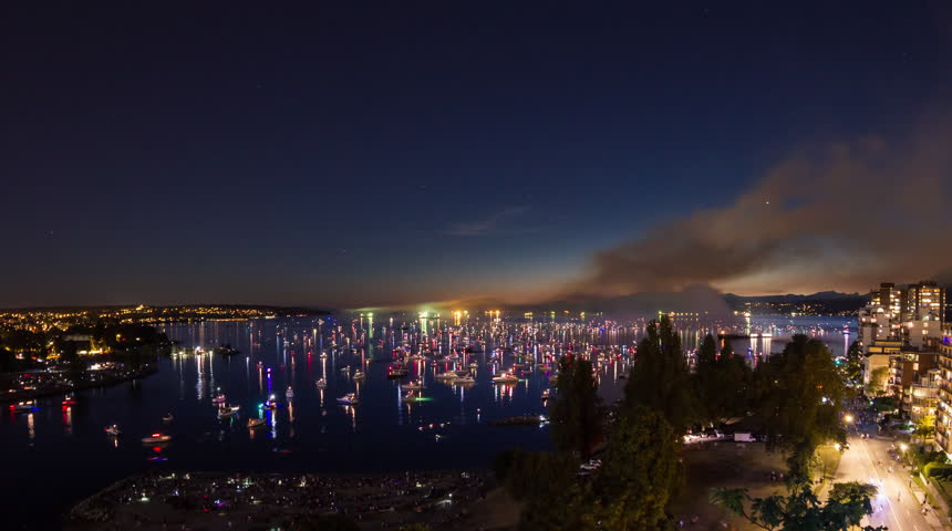 Time lapse of boats and people traffic at night after fireworks event at English Bay in downtown Vancouver, British Columbia, Canada
