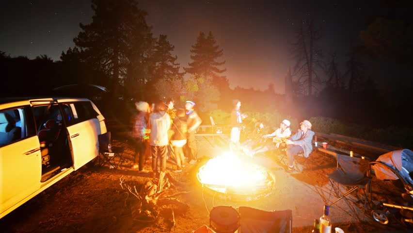 3 axis motion controlled Time-lapse footage with dolly right, tilt up, pan right & zoom in motion of campers surrounding bonfire in alpine mountain in Angels National Forest, California