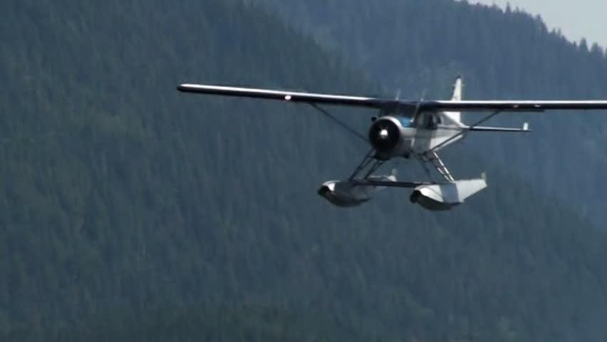 KETCHIKAN, AK - JUNE 5: Shot of a floatplane coming in for a landing on June 5, 2009 in Ketchikan, Alaska. - HD stock footage clip