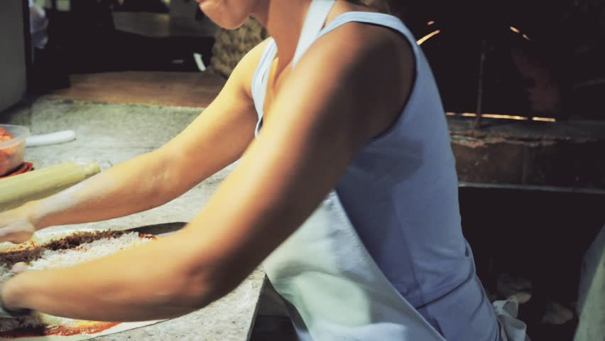 Female hands preparing pizza dough in restaurant. 4k - 4K stock footage clip