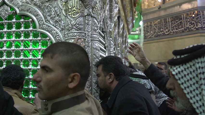 KARBALA, IRAQ - 2015: Visitors in front of Imam Hussein's tomb, slow motion at 100 fps. The Shrine of Hussein is one of the oldest mosques in the world and a holy site of Muslim Shia.