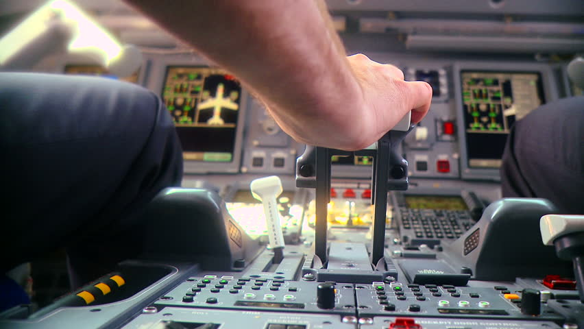 Pilot push thrust lever handle for takeoff a plane in the cockpit slow motion