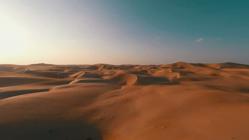 Flying backwards over picturesque sand dunes in the Arabian desert