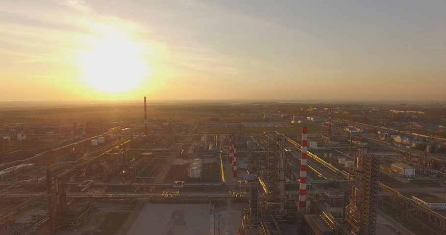Beautiful industrial plant with large pipes at sunset. Top view. Aerial. The smoke from the chimneys. Excellent video for movies and advertisements about the production, technology and business. | Shutterstock HD Video #12108083