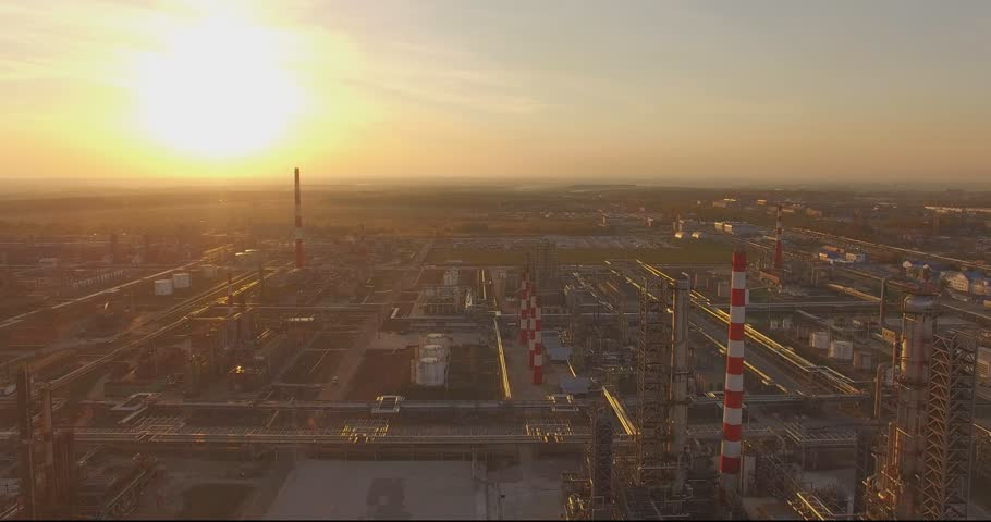 Beautiful industrial plant with large pipes at sunset. Top view. Aerial. The smoke from the chimneys. Excellent video for movies and advertisements about the production, technology and business. | Shutterstock HD Video #12108110