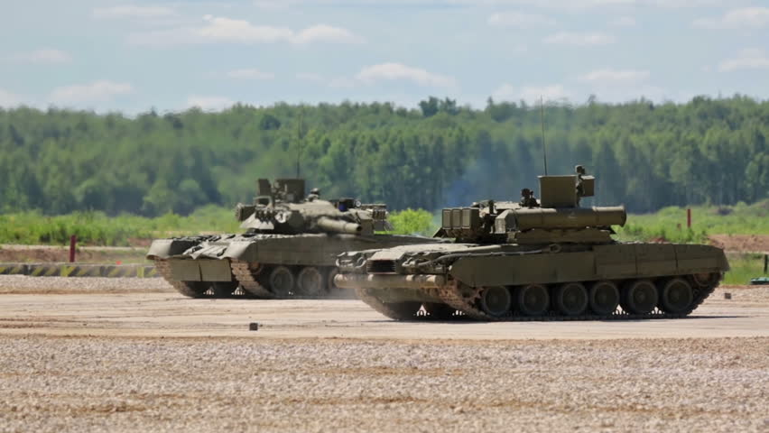 MILITARY GROUND ALABINO, MOSCOW OBLAST, RUSSIA - JUN 18, 2015: Russian tanks in show of military equipment on military ground at the International military-technical forum ARMY-2015 - HD stock footage clip