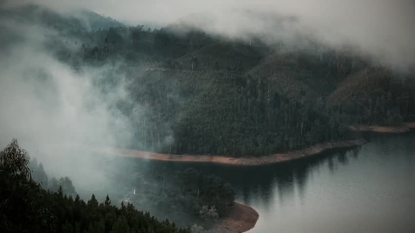 Cinemagraph Loop - View of a lake covered in fog during morning sunrise. Motion photo