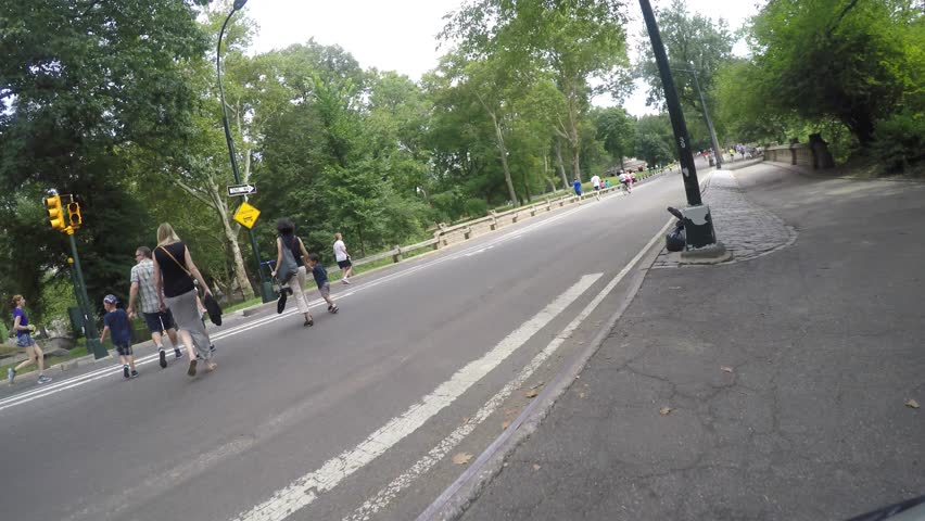 NEW YORK CITY, CENTRAL PARK, JULY 2015 - 4K DX POV GoPro Biking Driving Plate #1 - POV shot of bike cruising past people exercising and other bicycles towards the exit to upper east side | Shutterstock HD Video #12181136