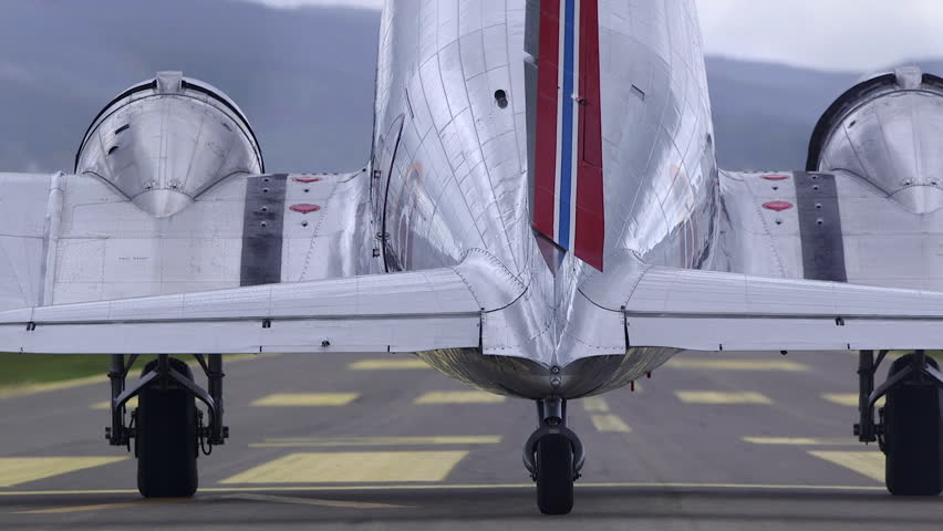 KJELLER AIRPORT NORWAY - SEPTEMBER 2015: DC-3 propeller airplane take off from airfield side view
