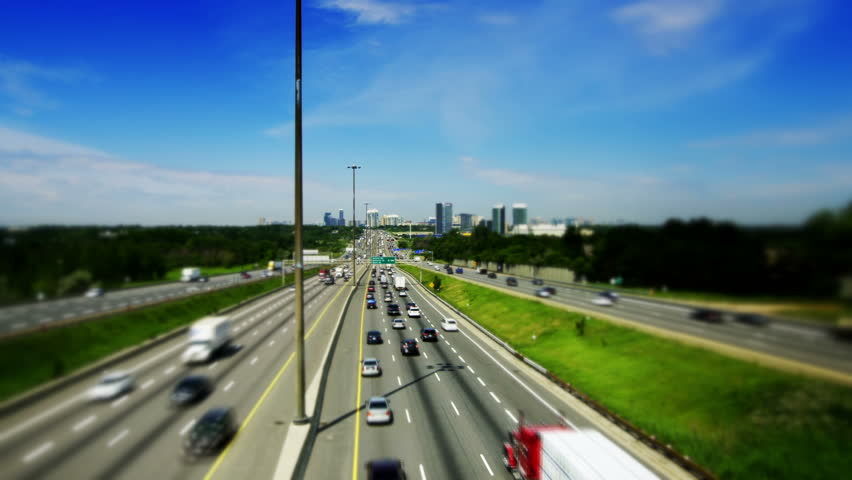 Tilt-Shift of King's Highway 401 near Toronto in Ontario Canada. The part of Highway 401 that passes through Toronto is the busiest highway in the world. - HD stock footage clip