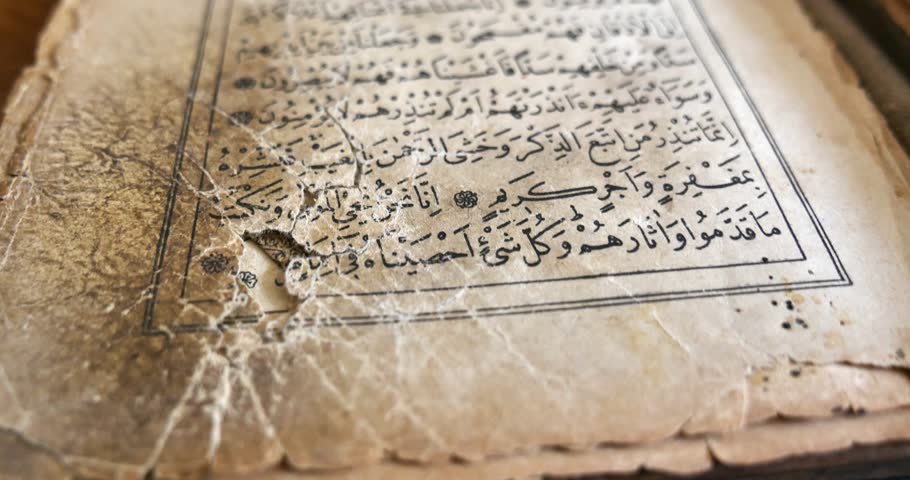 Footage of an old Quran, the shot is moving from the bottom to the top... - 4K stock video clip