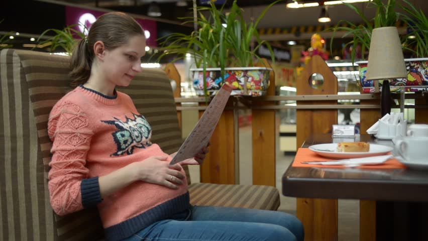 Pregnant Woman Eating Cake At The Mall Cafe Stock Footage ...