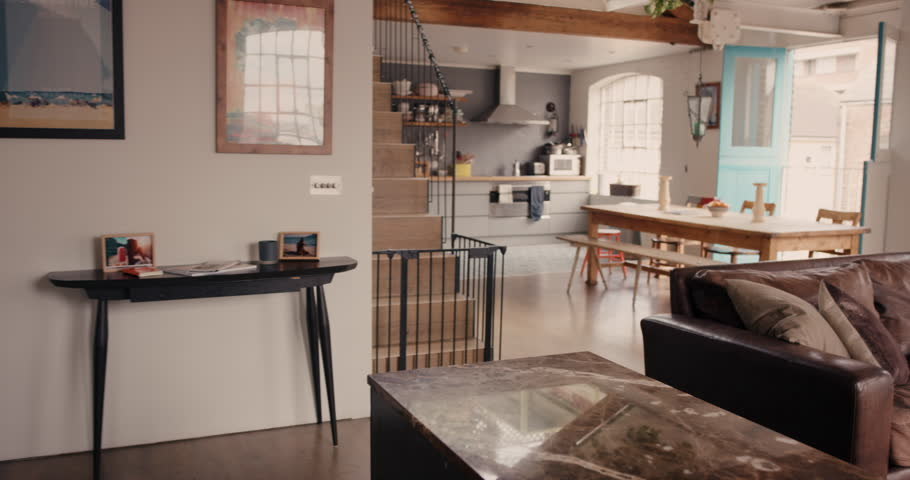 Home interior walk through from living room into kitchen warehouse conversion empty space modern apartment | Shutterstock HD Video #12273458