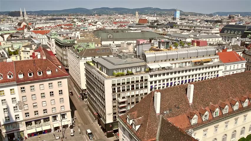 VIENNA, AUSTRIA - AUGUST 10, 2015: Aerial View Of Vienna City Skyline From The Most Prominent Building, The Stephansdom, Vienna's cathedral. - HD stock footage clip