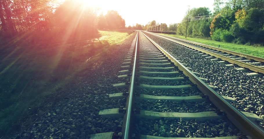 AERIAL. Camera flight from train tracks to the high summer sunset sky | Shutterstock HD Video #12308072