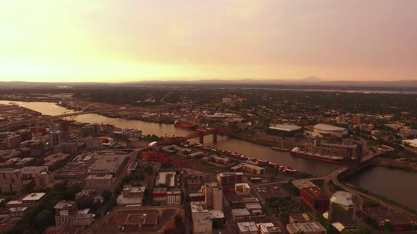 Aerial video of downtown Portland in Oregon at sunset on a hazy day. | Shutterstock HD Video #12313184