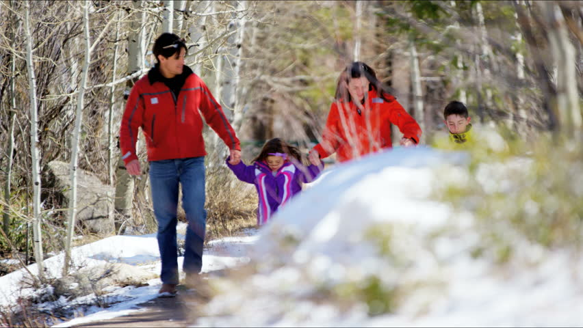 young family Caucasian parents son daughter outdoor walking lifestyle teamwork active confidence forest recreation nature travel RED DRAGON - 4K stock video clip