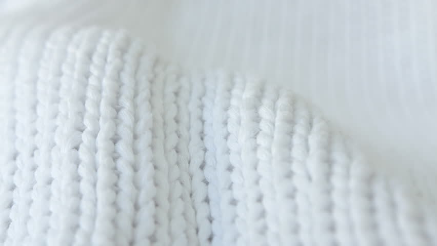 Soft white woollen fabric background HD stock footage. Soft white wool fabric background texture with a sliding camera move.