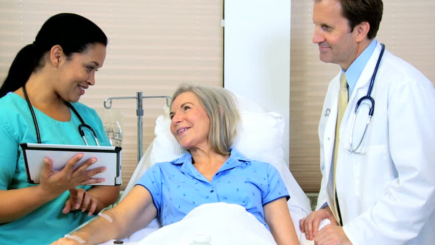 Medical clinical hospital care Caucasian senior female male consultant Hispanic nurse wireless technology touch screen tablet | Shutterstock HD Video #12354728