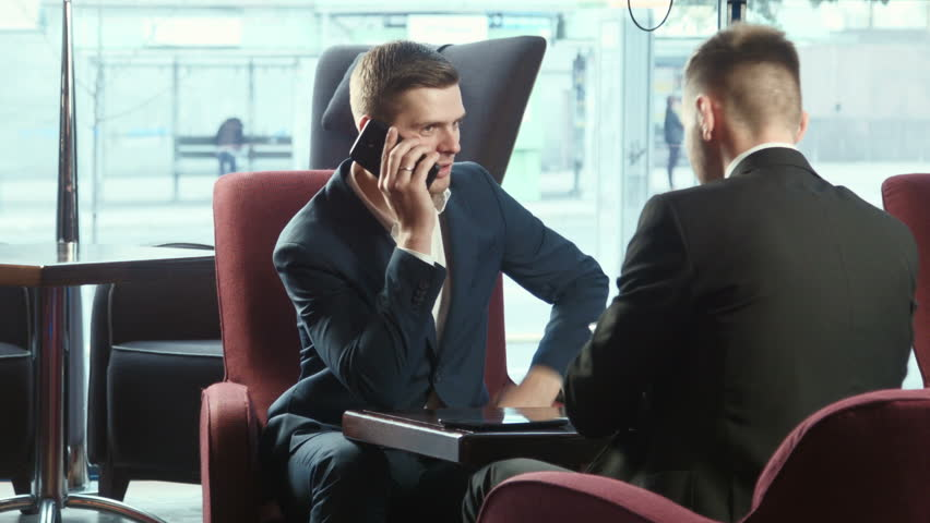 The businessman discusses by phone of a term of the contract
