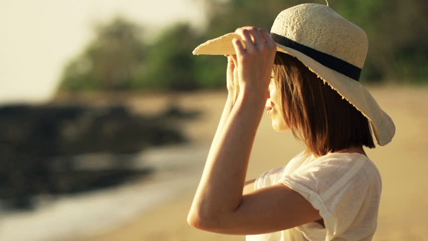 Woman with summer hat admire sunset on the beach, super slow motion  | Shutterstock HD Video #12361676
