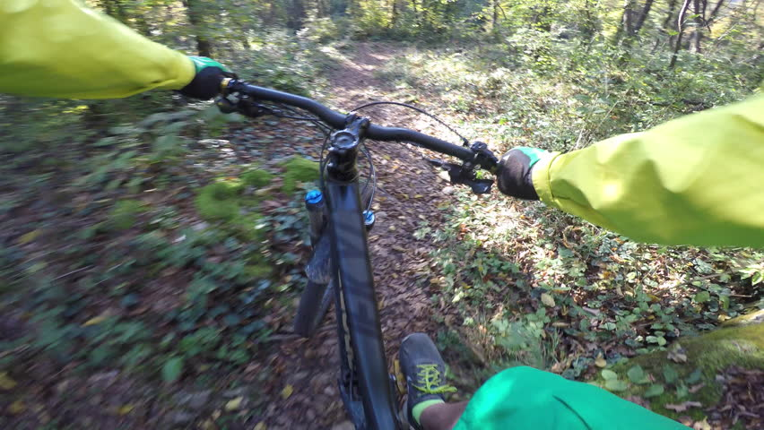 Mountain biker POV of riding on the forest trail - 4K stock footage clip