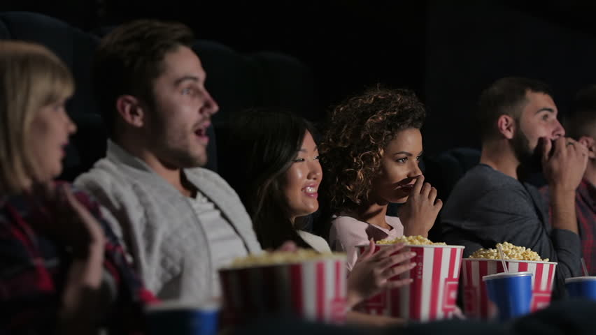 A Group Of People Watching A Movie Showing Emotion. Cinema ...