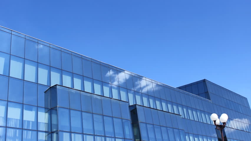 Lovely Beautiful Blue Glass Building with Cloudscape time lapse - HD stock video clip
