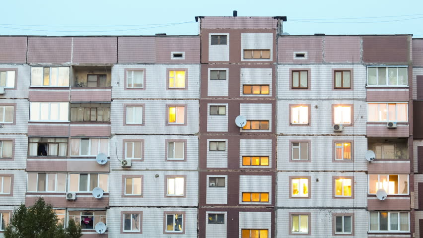 Multi-storey houses, in apartments that light up windows. Timelapse. | Shutterstock HD Video #12404633