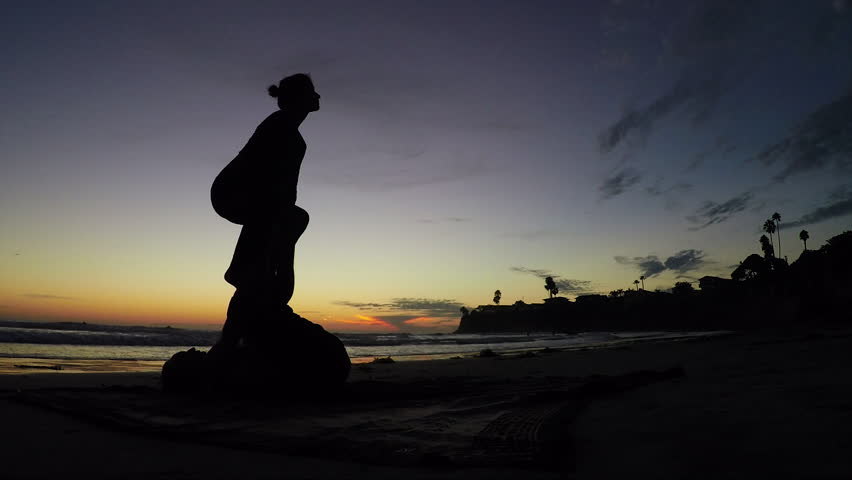 Acroyoga lifestyle beach sunset. Silhouette beauty shot. - HD stock footage clip
