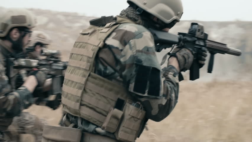 Slow motion of armed soldiers running forward to attack