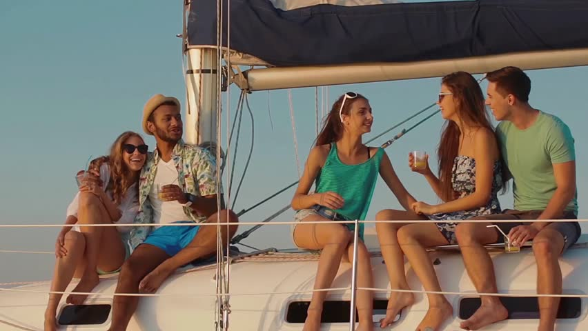 Young people relaxing on a yacht. Party on a yacht. Corporate party on a yacht. Young people having fun on a yacht. Walk on a yacht along the river. Cruise on a boat. | Shutterstock HD Video #12491501